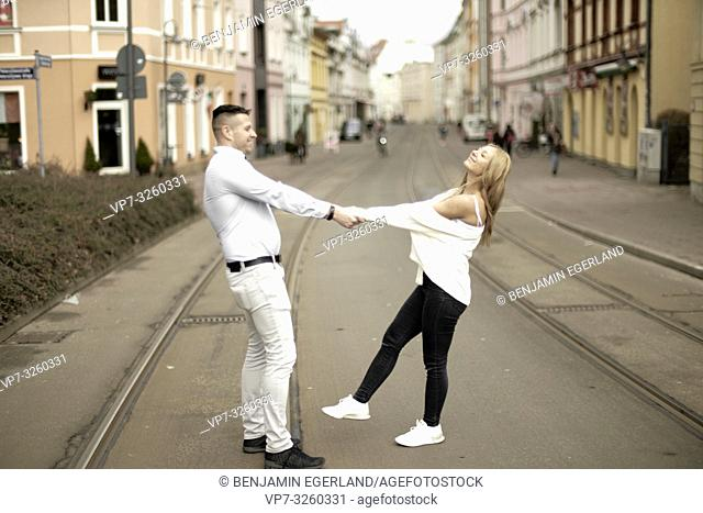 German couple dancing on street in city Cottbus, Brandenburg, Germany