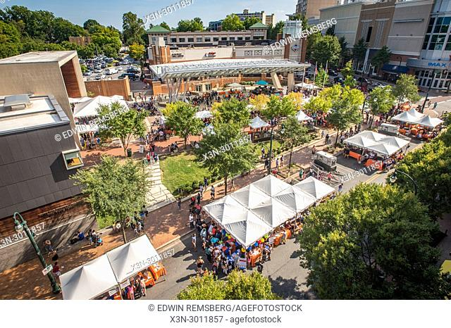 Overlooking crowded street festival with pop up tents at civic building in Silver Spring, Maryland. USA
