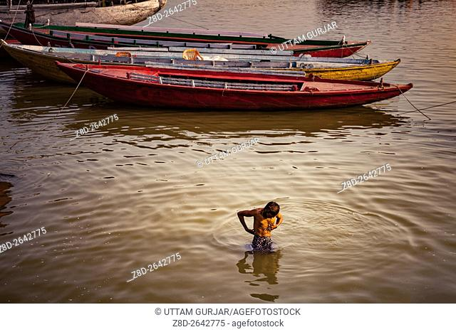 Pilgrims bathing, Morning activities at banks of river Ganges Ganga, Varanasi, Banaras, Uttar Pradesh, India