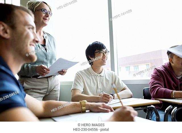 Professor and college students in classroom