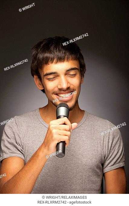 Teenager boy music singing singer happy microphone