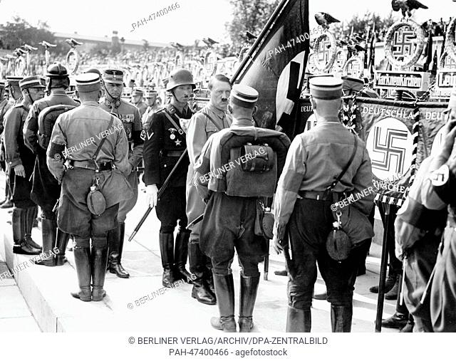 "Nuremberg Rally 1934 in Nuremberg, Germany - Deployment of members of the SA (Sturmabteilung) and SS (Schutzstaffel) during the consecration with the """"Blood..."