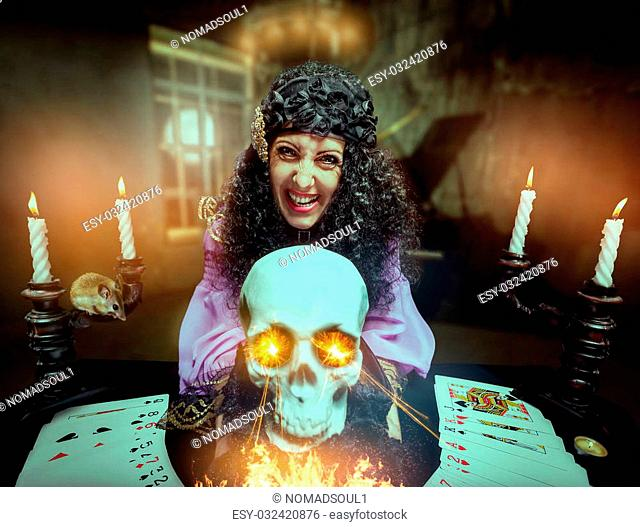 Sorceress practises witchcraft using the skull, its eyes are shining