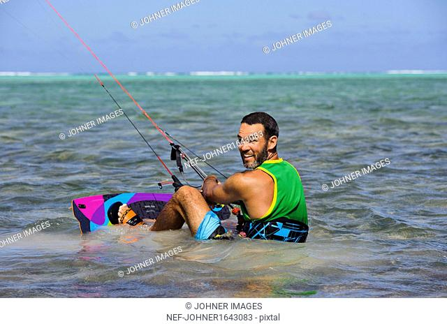 Mid adult man kite surfing