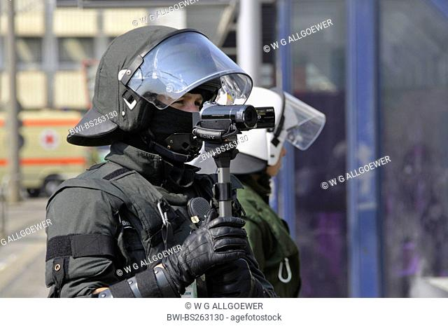 policeman shooting police operation at NPD deployment with video camera, Germany, Baden-Wuerttemberg