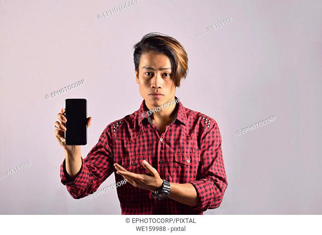 Young male model showing mobile phone, Pune, Maharashtra