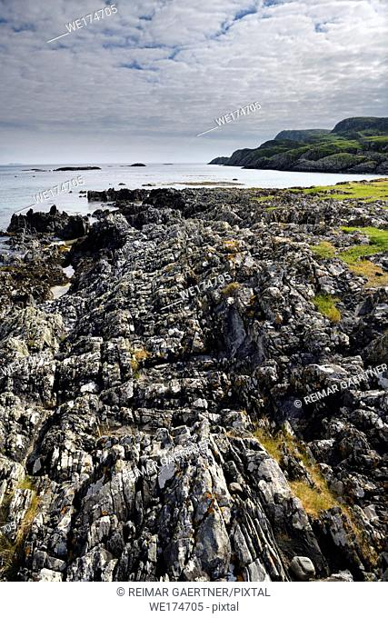 Flipped sedimentary rock layers at Sandeels Bay Atlantic Ocean at Isle of Iona Inner Hebrides Scotland UK