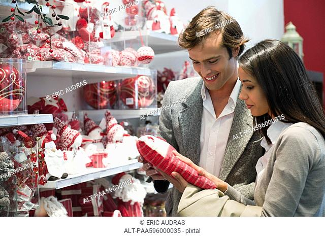 Couple shopping for Christmas decorations
