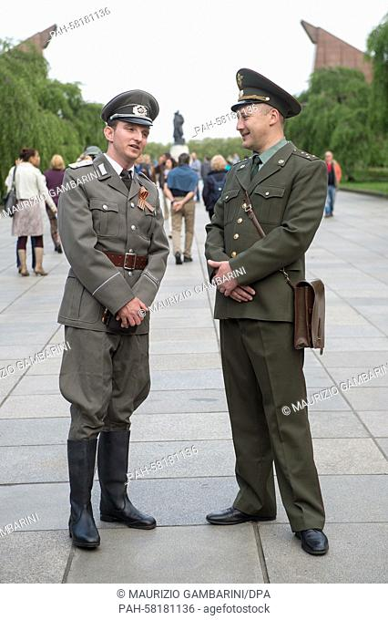 A visitor to the Soviet Memorial in Treptower Park wearing an NVA uniform (l) and another wearing Soviet uniform, Berlin, 8 May 2015