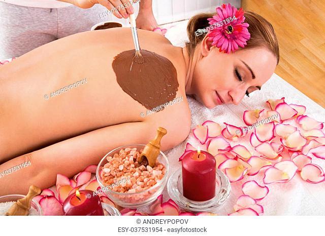 Woman enjoying skin treatment in spa centre