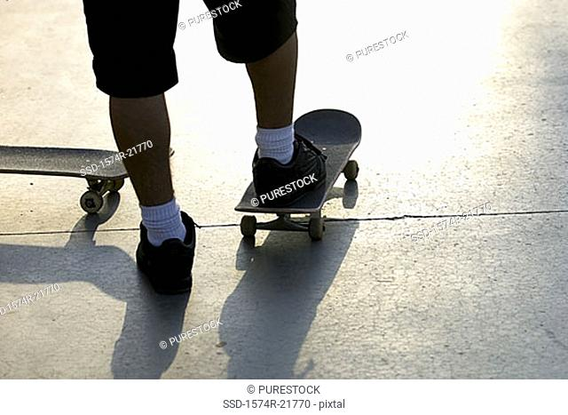 Low section view of a man on a skateboard