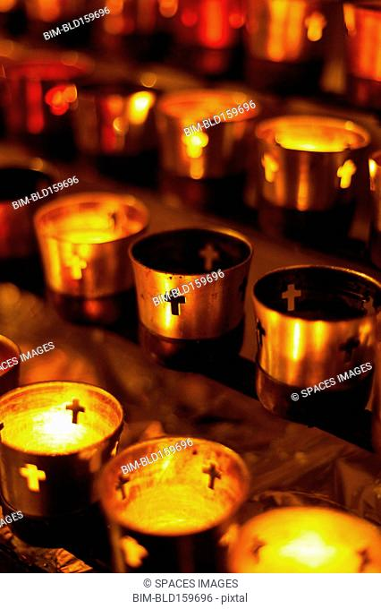 Close up of prayer candles glowing in church