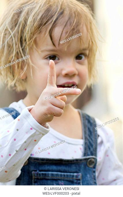 Little girl counting with her fingers