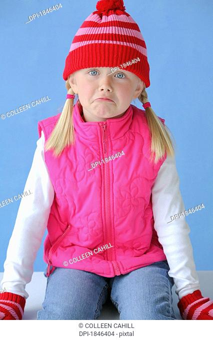 Child sitting, frowning