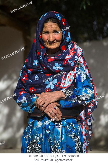 Afghan woman in her traditional pamiri house courtyard, Badakhshan province, Qazi deh, Afghanistan