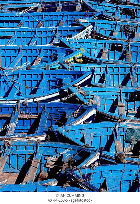 Small blue boats tied together in harbor, Close Up