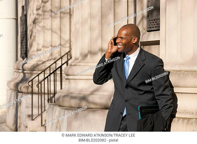 African American businessman talking on cell phone