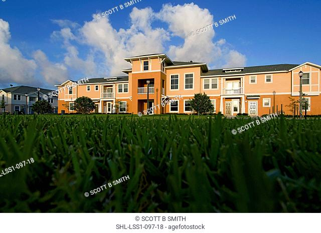 View of apartment complex from grass