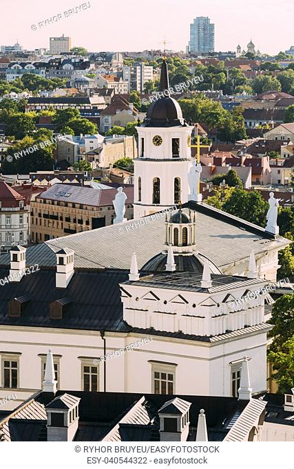 Vilnius, Lithuania. View Of Bell Tower Chapel, Angels On Roof Of Cathedral Basilica Of St. Stanislaus And St. Vladislav And Palace Of Grand Dukes Of Lithuania