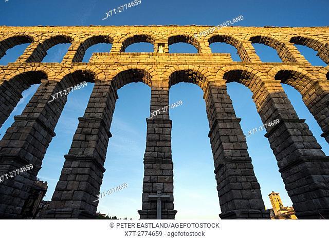 Late evening sunlite on Segovia's 1st century Roman Aqueduct in the Plaza Azuguejo, Segovia, Spain