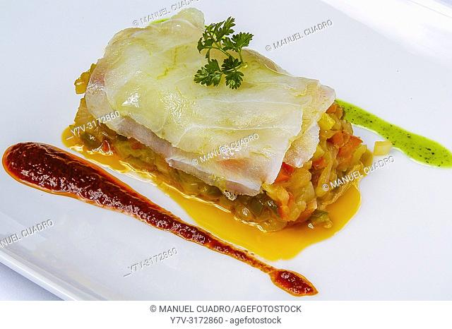 Rodajas de bacalao a la Riojana con salsa revuelta y pimiento rojo (sliced riojan style cod with sauce and red pepper). Cuisine of La Rioja, Spain