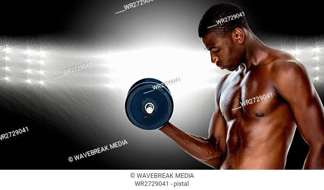 Muscular man lifting a dumbbell