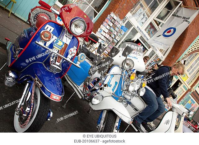 Elaborately decorated Mopeds on Madeira Drive during motorbike festival