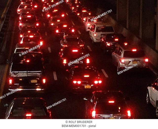 High angle view of glowing taillights of cars in traffic