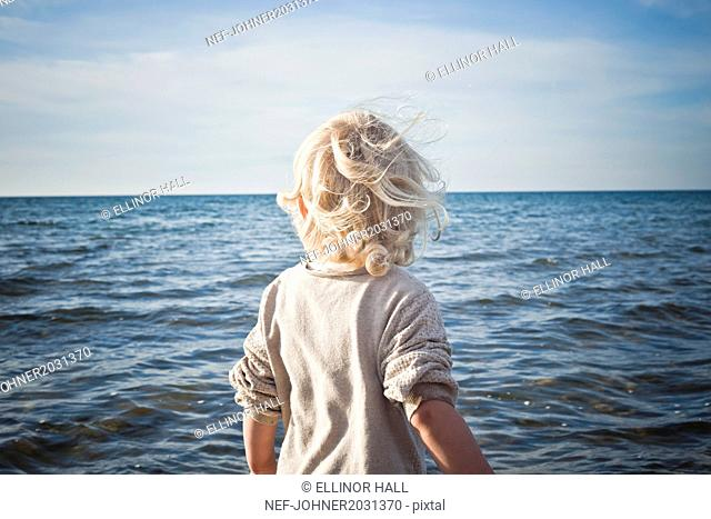 Child looking at sea