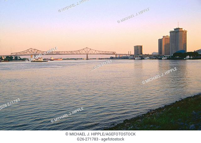 New Orleans skyline at dusk from the banks of Mississipi River. Louisiana. USA