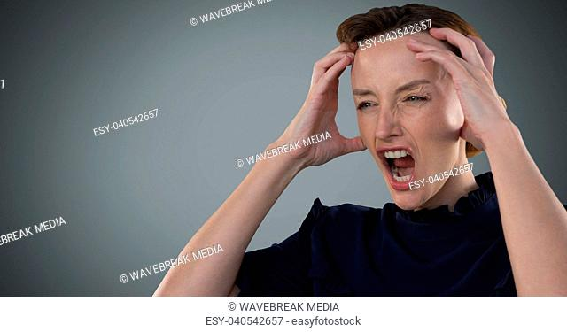 Businesswoman screaming with stress and grey background