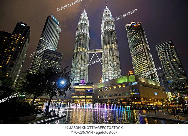 Night time light and water fountain show at KLCC and the Petronas Twin Towers, Kuala Lumpur, Malaysia