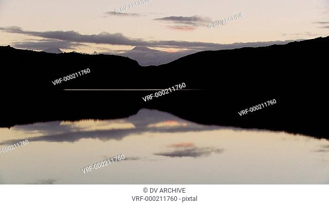 Pan across lakes and peaks in Patagonia, Argentina at dusk