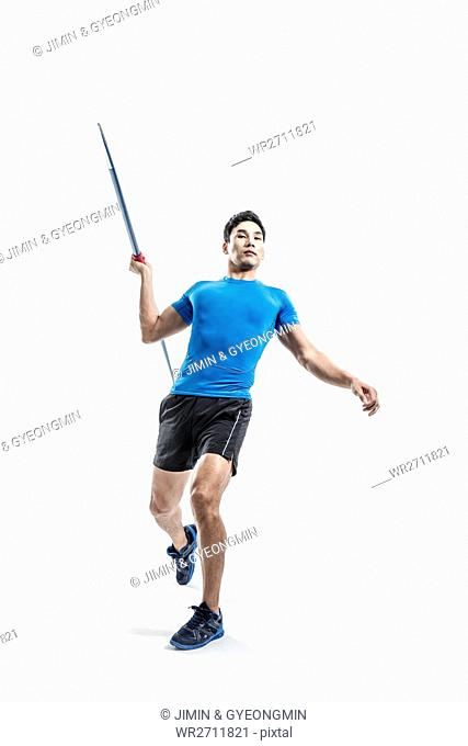 Male athlete posing with javelin