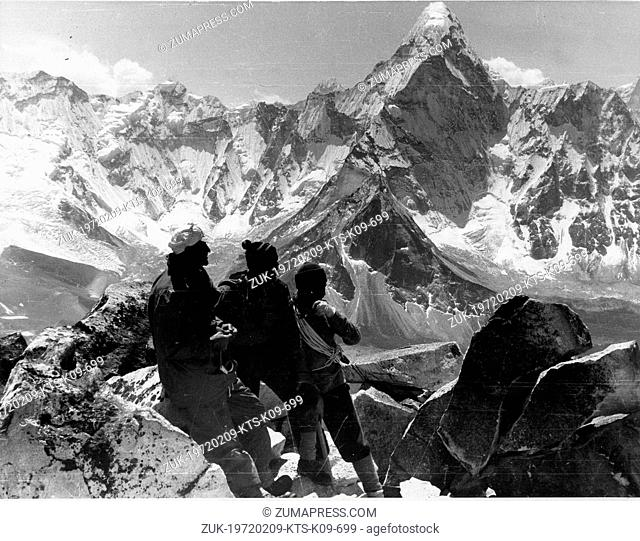 Solo Khumbu, Nepal - Early climbers with the dramatic himalayan peak of Ama Dablam in the background. 1950's Nepal Everest Expeditions