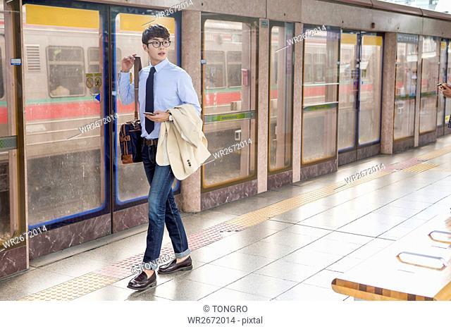 Businessman walking at subway station