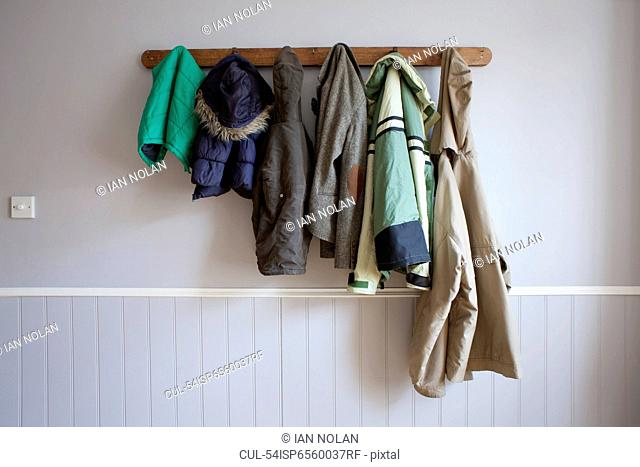 Coats hanging on coat rack