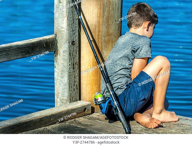 A young bboy contemplating the water . . . where are the fish? (MR available)