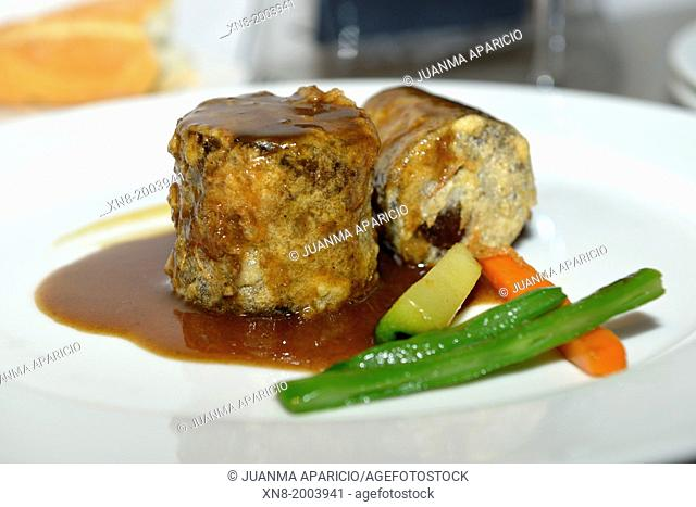 Dish braised oxtail in wine with vegetables
