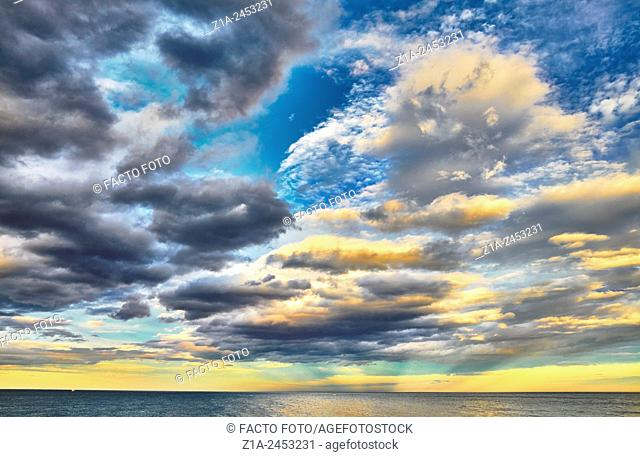 Sunset seascape with clouds at the Mediterranean sea. Denia. Alicante. Valencia Community. Spain