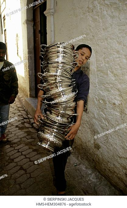 Morocco, Middle Atlas, Fez, Imperial City, medina listed as World Heritage by UNESCO, boy loaded with receptacles