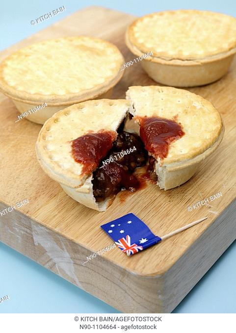 Australian meat pies on a chopping board