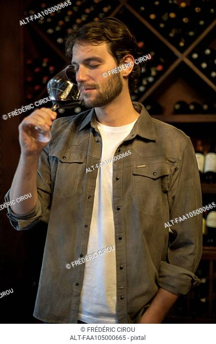Connoisseur smelling glass of wine