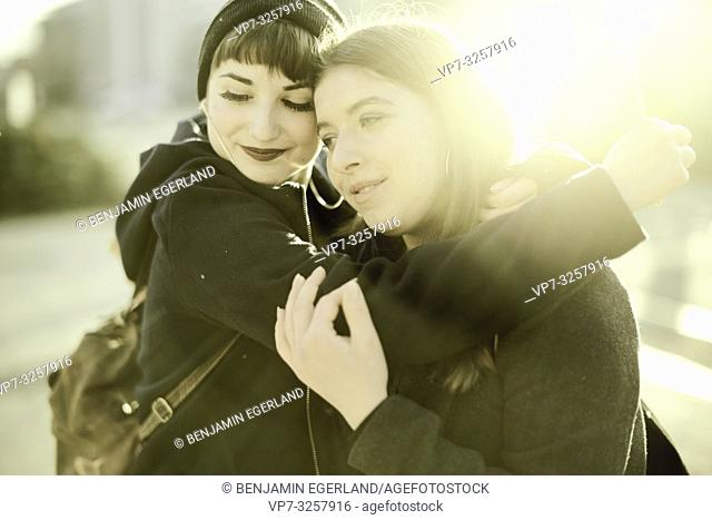 two women embracing, in city Cottbus, Brandenburg, Germany