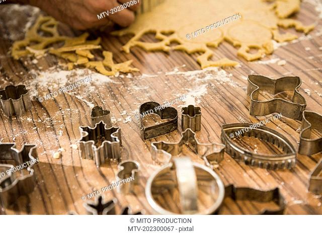 Man cutting out cookies from dough, Munich, Bavaria, Germany