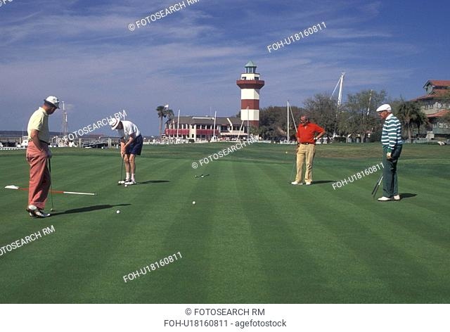 golf, Hilton Head Island, SC, South Carolina, Golfer putting on the 18th Hole at the MCI Heritage Golf Classic in Harbour Town on Hilton Head Island