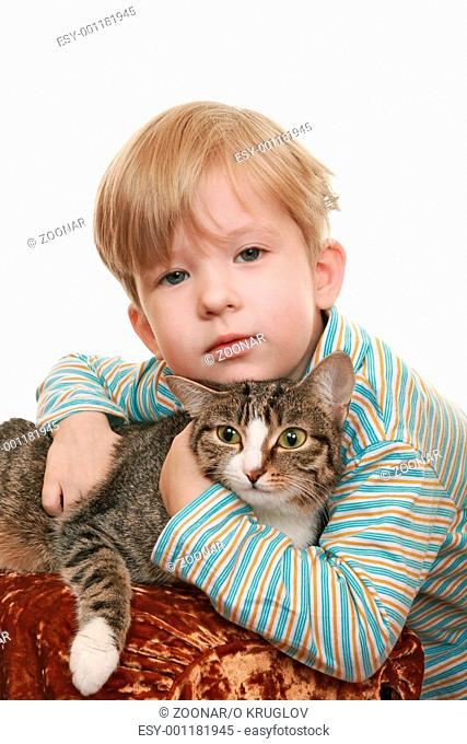 Thoughtful boy with an angry cat. Studio photography