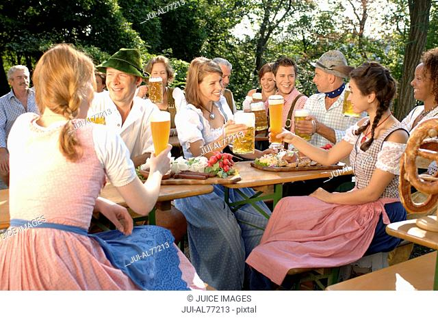 View of a crowd of people drinking beer, beergarden, Munich, Bavaria, Germany