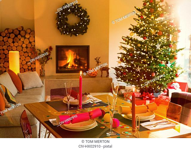 Ambient dining table, fireplace and Christmas tree in living room