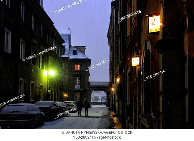 Krzywe Kolo street in the evening in heavy snowfall, Old Town - UNESCO World Heritage, Warsaw, Poland, Europe